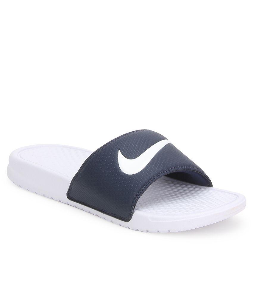quality design 846de 49c93 Nike Benassi Swoosh Navy Flip Flops
