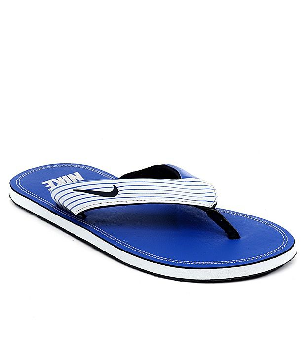 super popular 54eab 8a1a8 Nike Blue Slippers