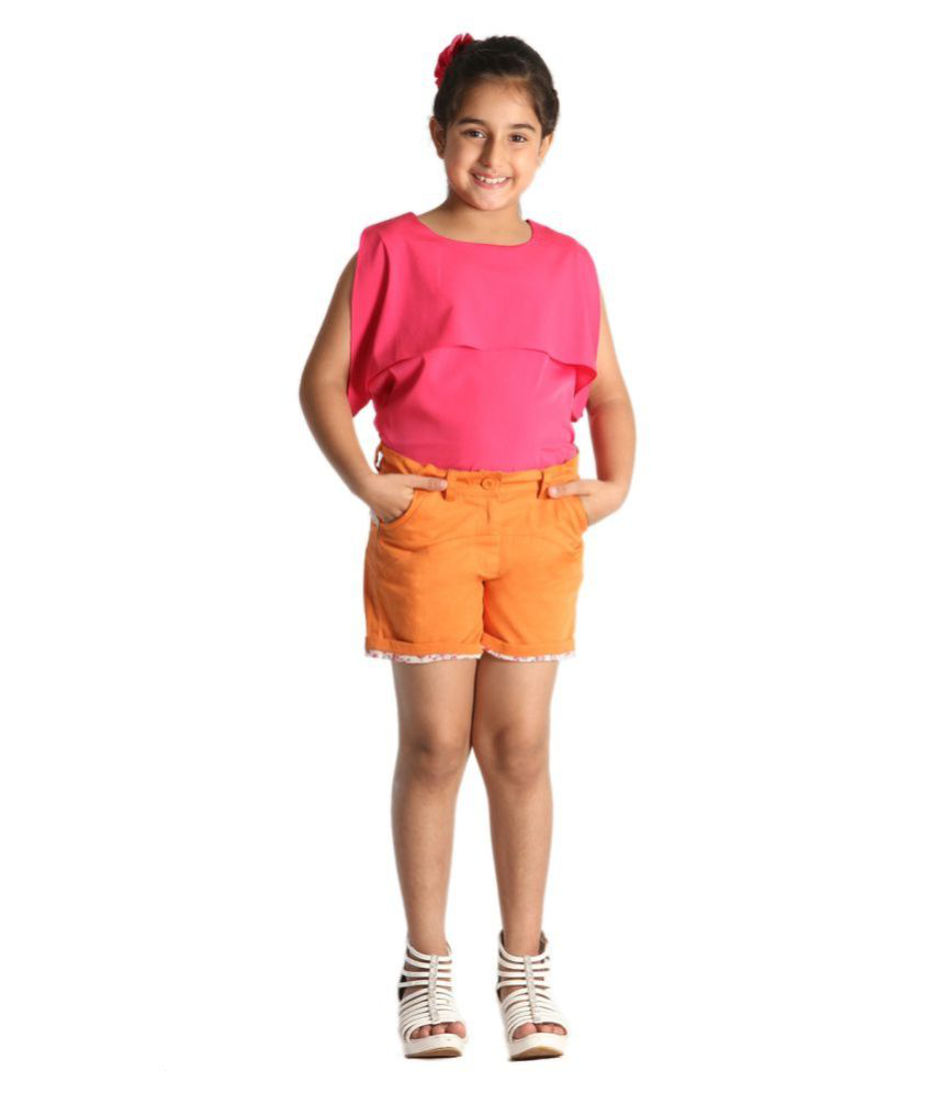 Orange shorts for girls with floral folded hem and white lace at the back by Paul & doll