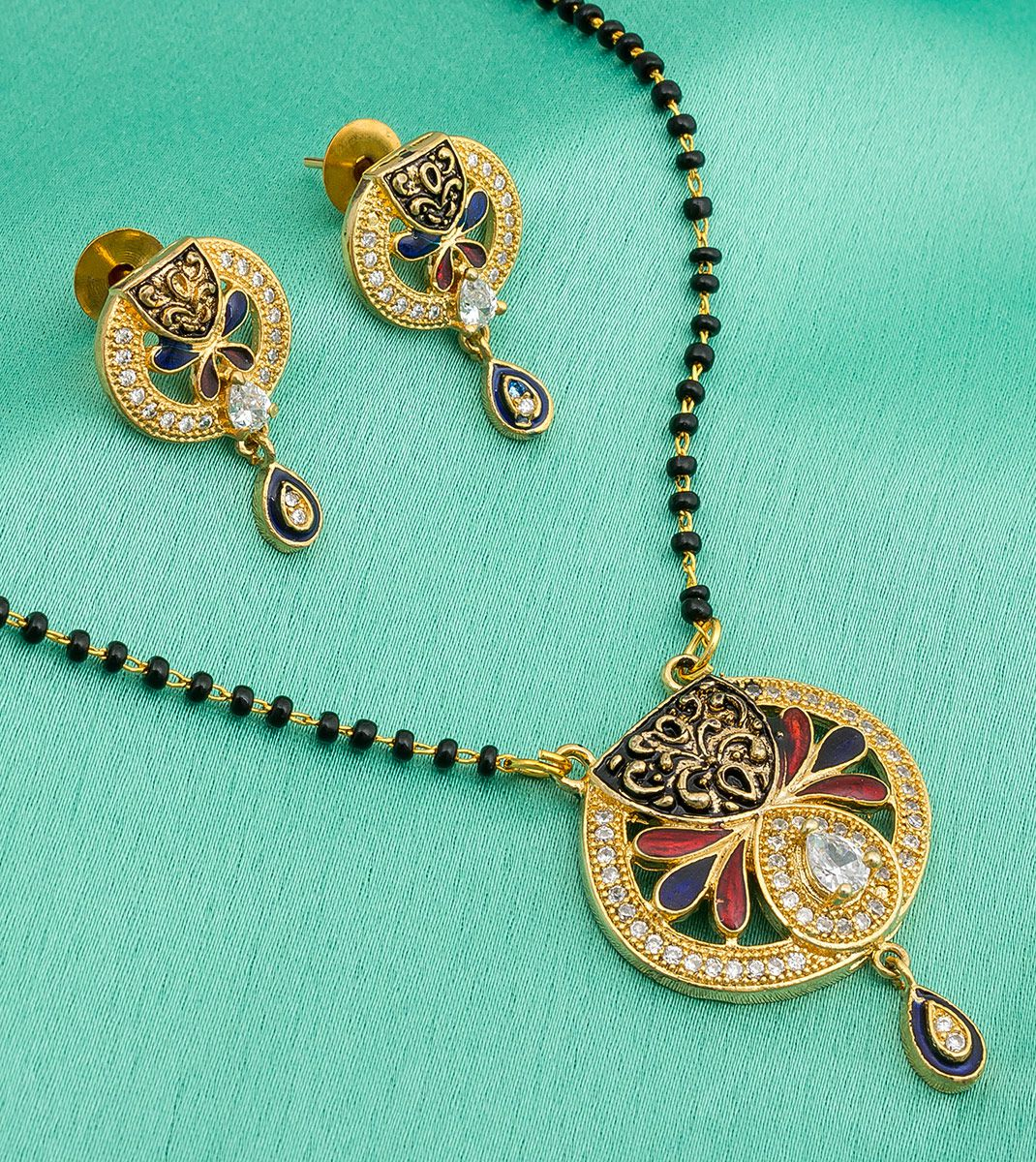 The Luxor Designer Gold Tone American Diamond Black Bead Stylish Mangalsutra Set for Women with Earrings